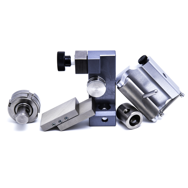 Specimen holder, grips and adapters for universal testing machines and force gauges